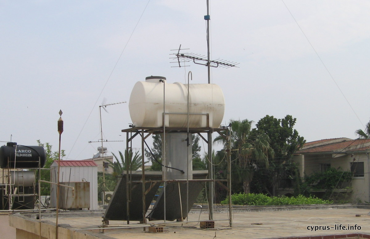 water tanks with solar panels below